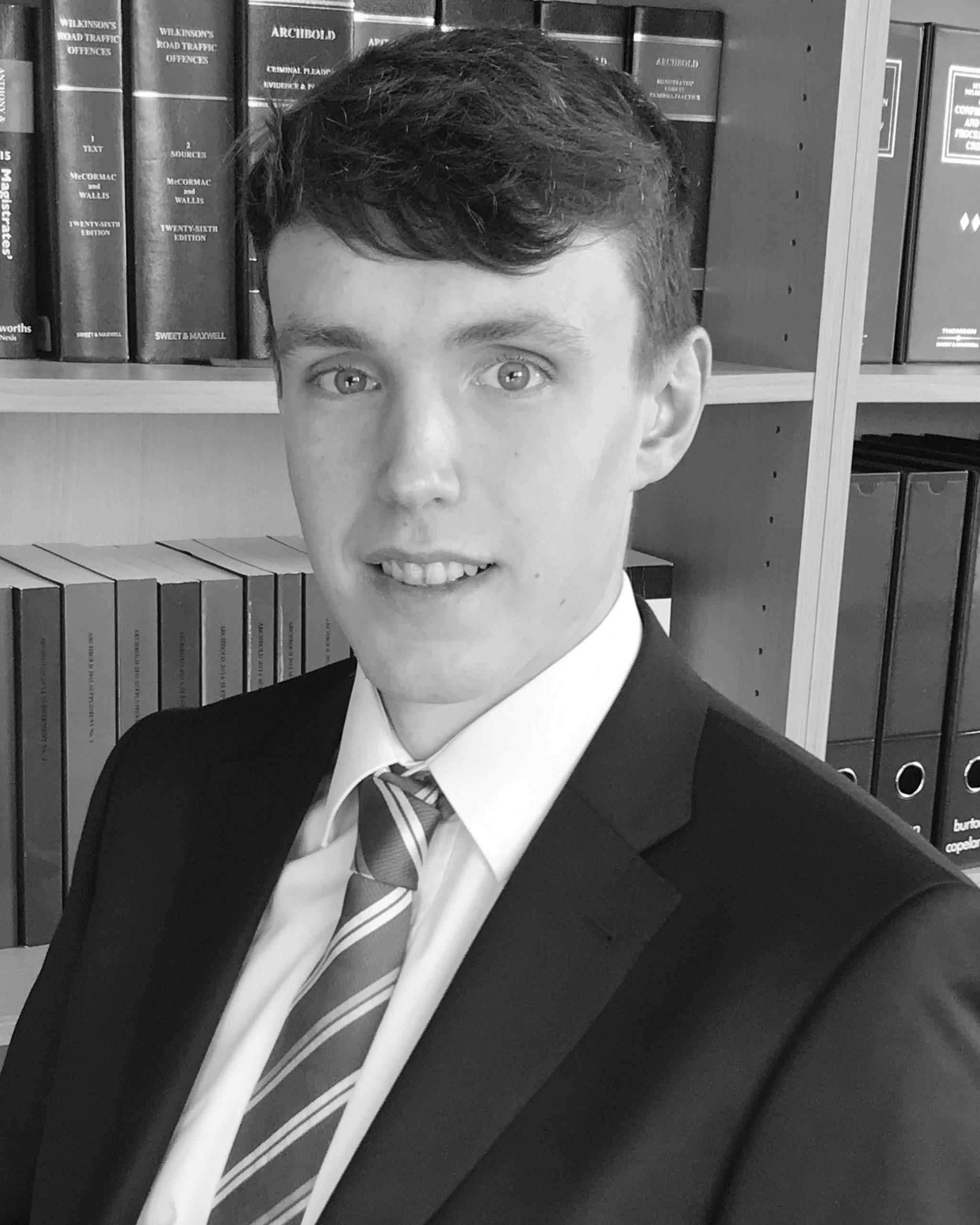 A professional headshot of Burton Copeland Paralegal, Daniel Walton.